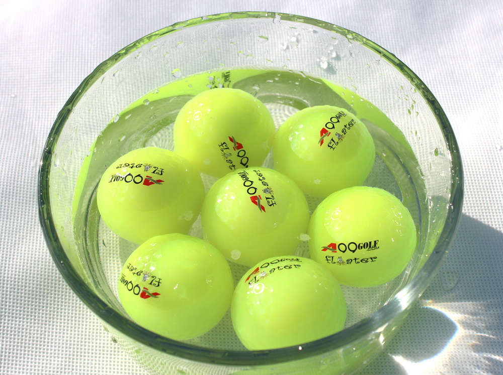 Floater Balls Neo Green in water.jpg